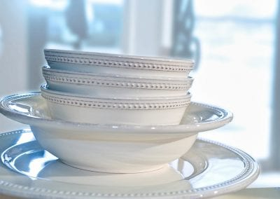 white dishes stacked product lifestyle