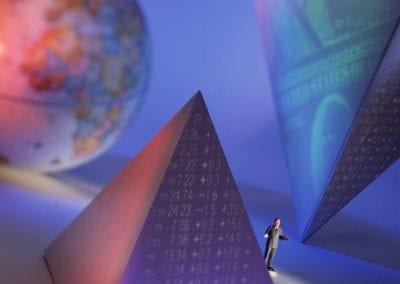 pyramids, man and globe