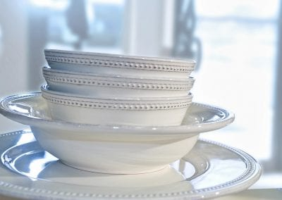 white-dishes-stacked-product-lifestyle