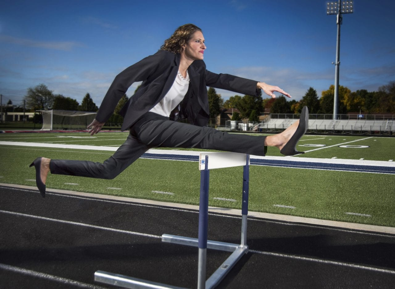 Sports hurdles, business woman