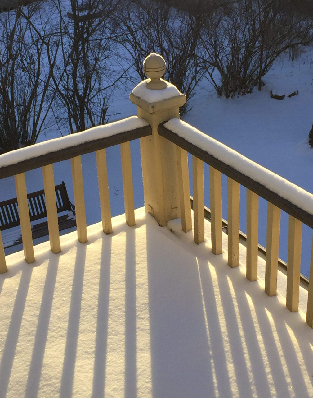 winter sunlight through slats on upper porch.