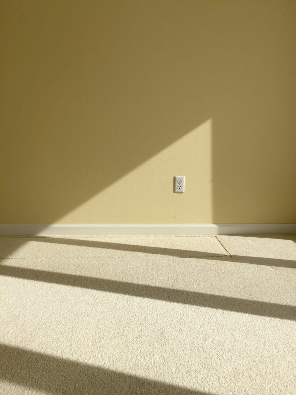 triangle winter light on wall and floor