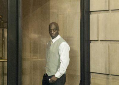 doorman in lobby crop top